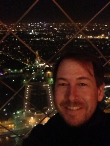Top of the Eiffel tower at midnight